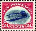 24 cent red U.S. stamp with biplane.